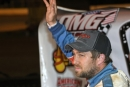 Michael Chilton waves to the Ponderosa Speedway crowd April 29 after his Old Man's Garage Spring Nationals victory in Junction City, Ky. (Brian McLeod)