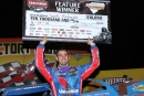 Josh Richards shows off his big check April 29 after his $10,000 World of Outlaws Craftsman Late Model Series victory at Carolina Speedway near Gastonia, N.C. (ZSK Photography)
