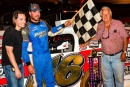 Jonathan Davenport visits Rome (Ga.) Speedway's victory lane May 29 with track owner Mickey Swims (right) and his grandson Chase Swims (left). (Mike Blevins)