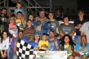 More than two dozen folks joined Jackie Boggs in victory lane May 29 after his Boone Coleman Memorial Gator 50 victory at Portsmouth (Ohio) Raceway Park. (Tyler Carr)