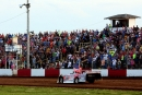 Tony Jackson Jr. carried Old Glory in May 29 pre-race ceremonies and grabbed the checkered flag in Monett (Mo.) Speedway's MARS DIRTcar Series race. (Ron Mitchell)