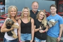 Bobby Pierce's 2016 UMP DIRTcar Summernationals championship team, including (l-r) his mother Angie, sister Ciarra, father Bob, girlfriend Maddy Supp and Pierce. The clan's dogs joined them in attending every event (the kitten didn't). (DirtonDirt.com)