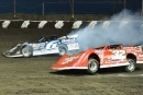 Bobby Pierce (32) takes command as Jonathan Davenport (6) goes up in smoke on the third lap of Macon (Ill.) Speedway's Lucas Oil Series event July 26. (heathlawsonphotos.com)