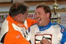 Winner Clint Smith is congratulated by third-finishing Mike Head (left) at Green Valley Speedway's Bama Bash on March 13, 2005, in Glencoe, Ala. (Brian McLeod)