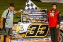 Eric Cooley picks up a $2,500 check from series director Charles Thrash at Magnolia Motor Speedway after his first Mississippi State Championship Challenge Series triumph. (Chris McDill)