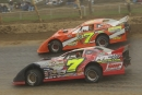 Matt Miller (7) goes under Ben Adkins (B7) en route to his Oct. 9, 2005, UMP Fall Nationals victory at Ohio's Eldora Speedway. (DirtonDirt.com)