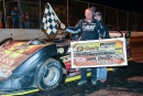David Breazeale shows off his $15,000 paycheck Oct. 22 at Whynot Motorsports Park after his victory in the 22nd annual Coors Light Fall Classic. (foto-1.net)