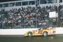 Don O'Neal takes the checkers May 8, 2004, at La Salle (Ill.) Speedway in Stacker 2 Xtreme DirtCar Series action. (Greg Bauer)