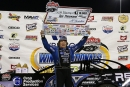 Scott Bloomquist holds his $10,000 check after winning the 50-lap Wrisco  Winternationals feature on Feb. 17 at East Bay Raceway Park in  Gibsonton, Fla. (Mike Ruefer)