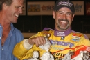 Billy Moyer of Batesville, Ark., celebrates in victory lane with the traditional bolls of cotton after winning the inaugural Cotton Pickin' 100 at Magnolia Motor Speedway in Columbus, Miss., on Oct. 24, 2004. (Brian McLeod)