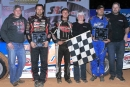 The family of the late Bill Hendren join race winner Trent Ivey, runner up Ryan Atkins and third-place finisher Chris Ferguson following the SECA-sanctioned Bill Hendren Memorial at Cherokee Speedway. (Zack Kloosterman/ZSK Photography)