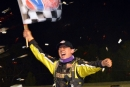 Devin Moran waves the checkers in Atomic Speedway's victory lane as the confetti appears after his first World of Outlaws Craftsman Late Model Series victory. (Stephen Wright)