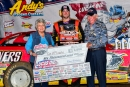 Tim McCreadie receives his $6,000 check for winning the Tribute to Don and Billie Gibson event on May 26 at Lucas Oil Speedway in Wheatland, Mo., from the Gibsons, the founders of the Show-Me 100. (heathlawsonphotos.com)