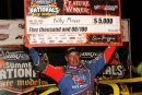 Billy Moyer shows off his paycheck June 20 at Jacksonville (Ill.) Speedway after his series-leading 96th career UMP DIRTcar Summernationals victory. (Jim DenHamer)