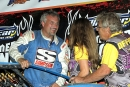 Dennis Erb Jr. is congratulated by Tri-City promoters Kevin and Tammy Gundaker after June 23's UMP DIRTcar Summernationals victory. (Jim DenHamer)