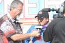 WoO announcer Rick Eshelman interviews winner Brandon Sheppard after his victory in the 30-lap Firecracker 100 preliminary feature on June 24 at Lernerville Speedway in Sarver, Pa. (Jason Shank)