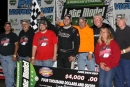 Dona Marcoullier and his supporters enjoy victory lane June 24 after his Ethanol Tour victory at Oakshade Raceway in Wauseon, Ohio. (Steve Datema)